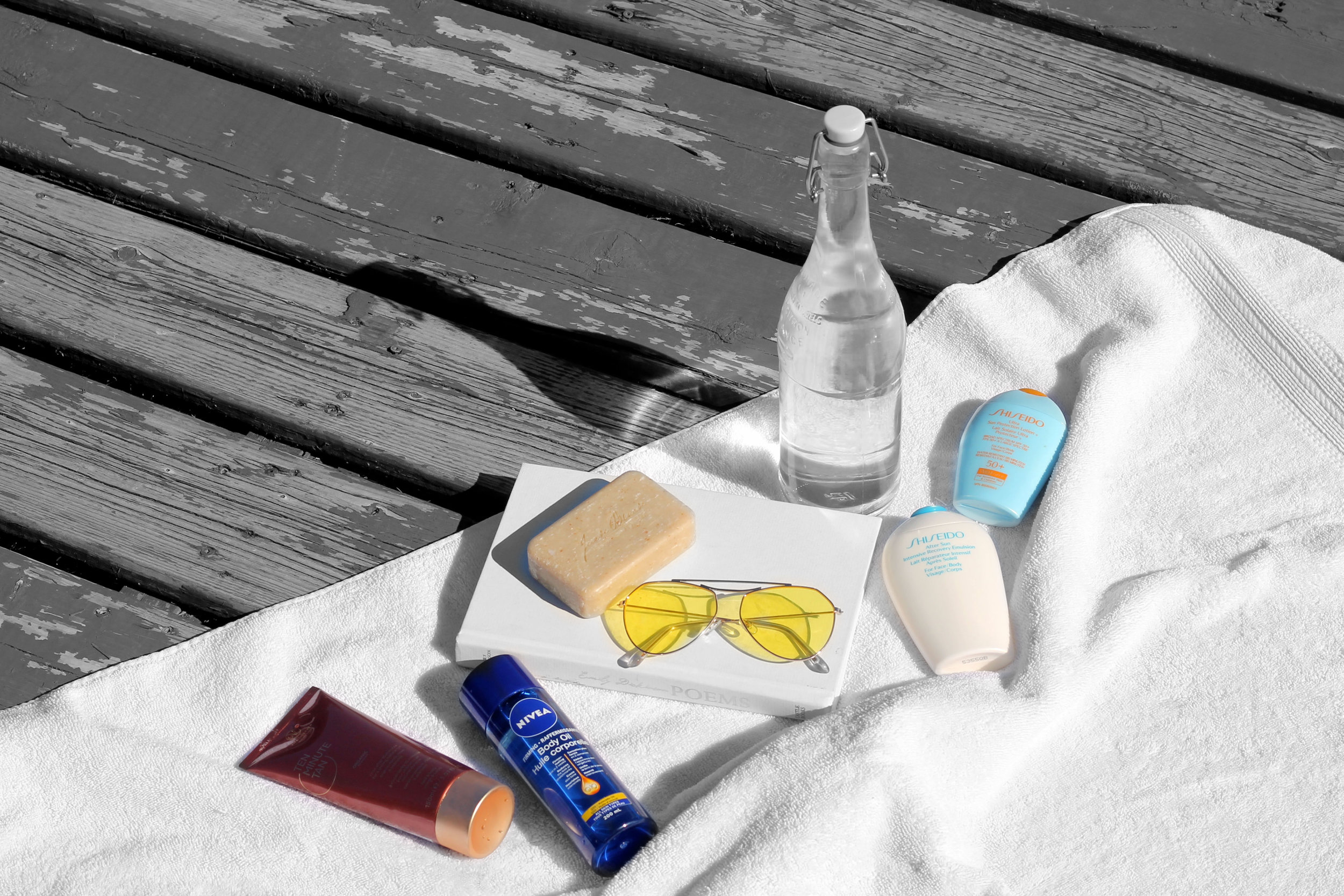 Best Products To Achieve and Maintain a Summer Tan including Vita Liberate Ten Minute Tan, Nivea Q10 Firming Body Oil, Shiseido After Sun, Sunscreen and Jack Black Turbo Body Bar