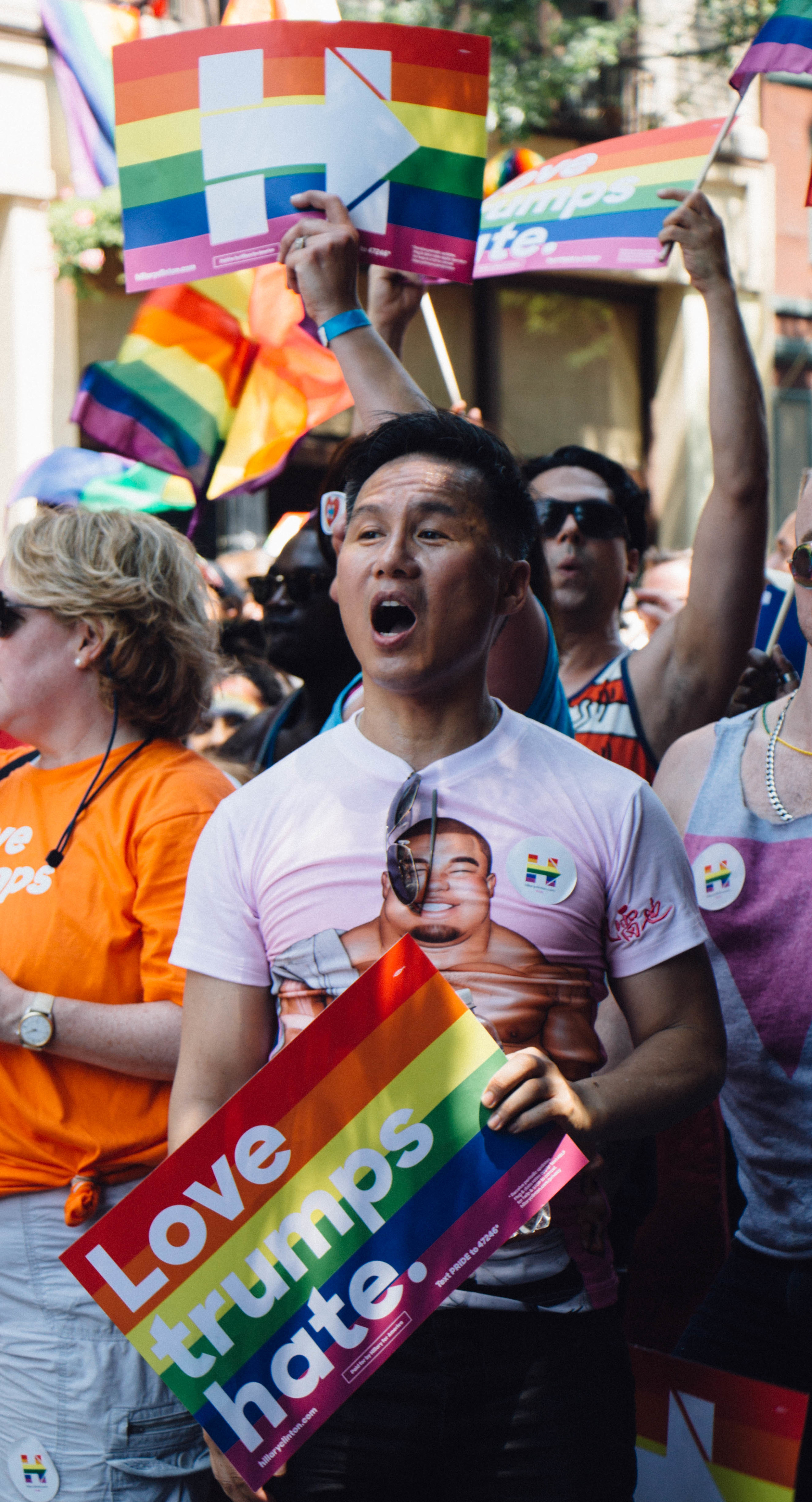 Actor B.D. Wong marches in the parade with fellow Hillary Clinton supporters.