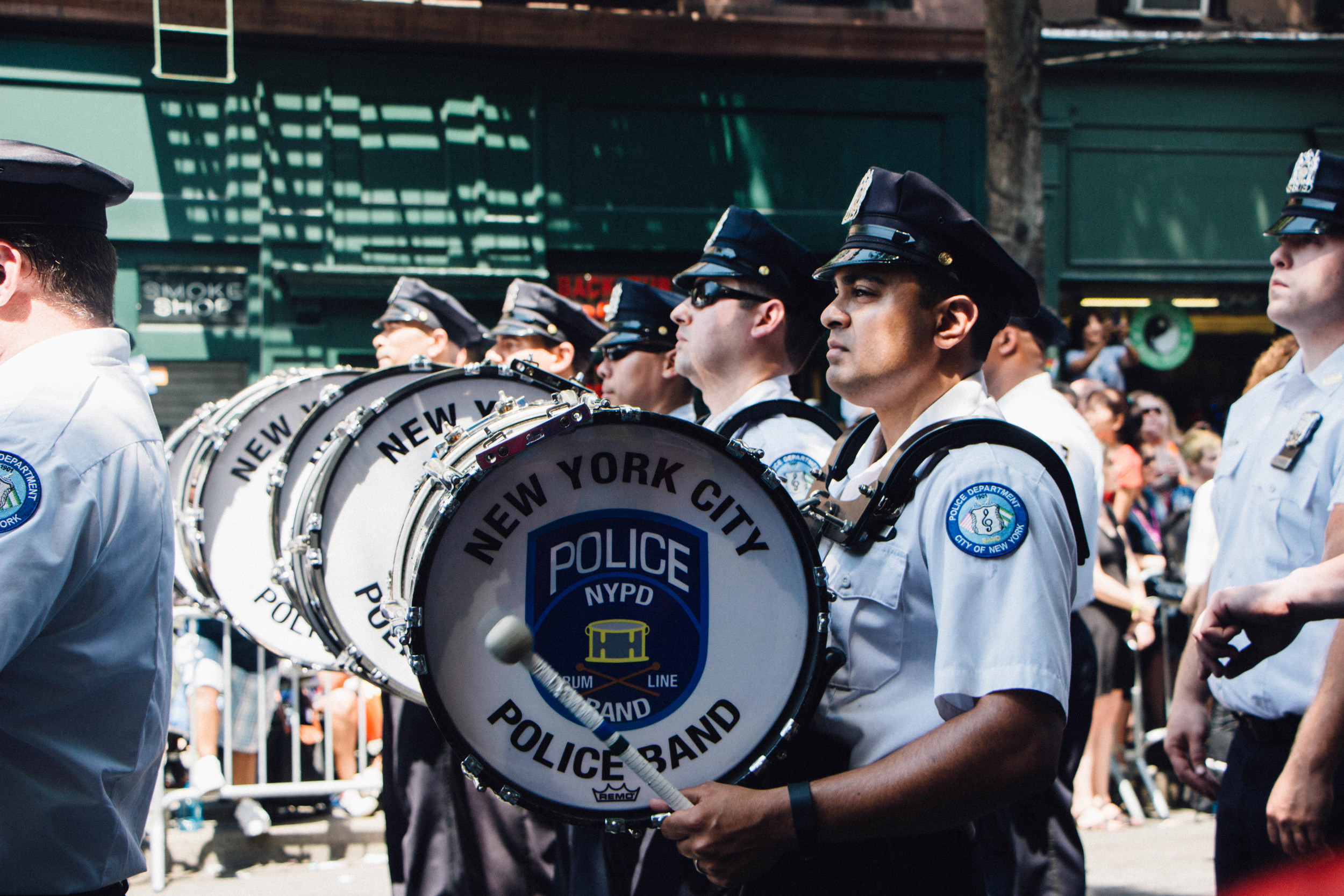 The New York Police Department's Police Band march down the streets.