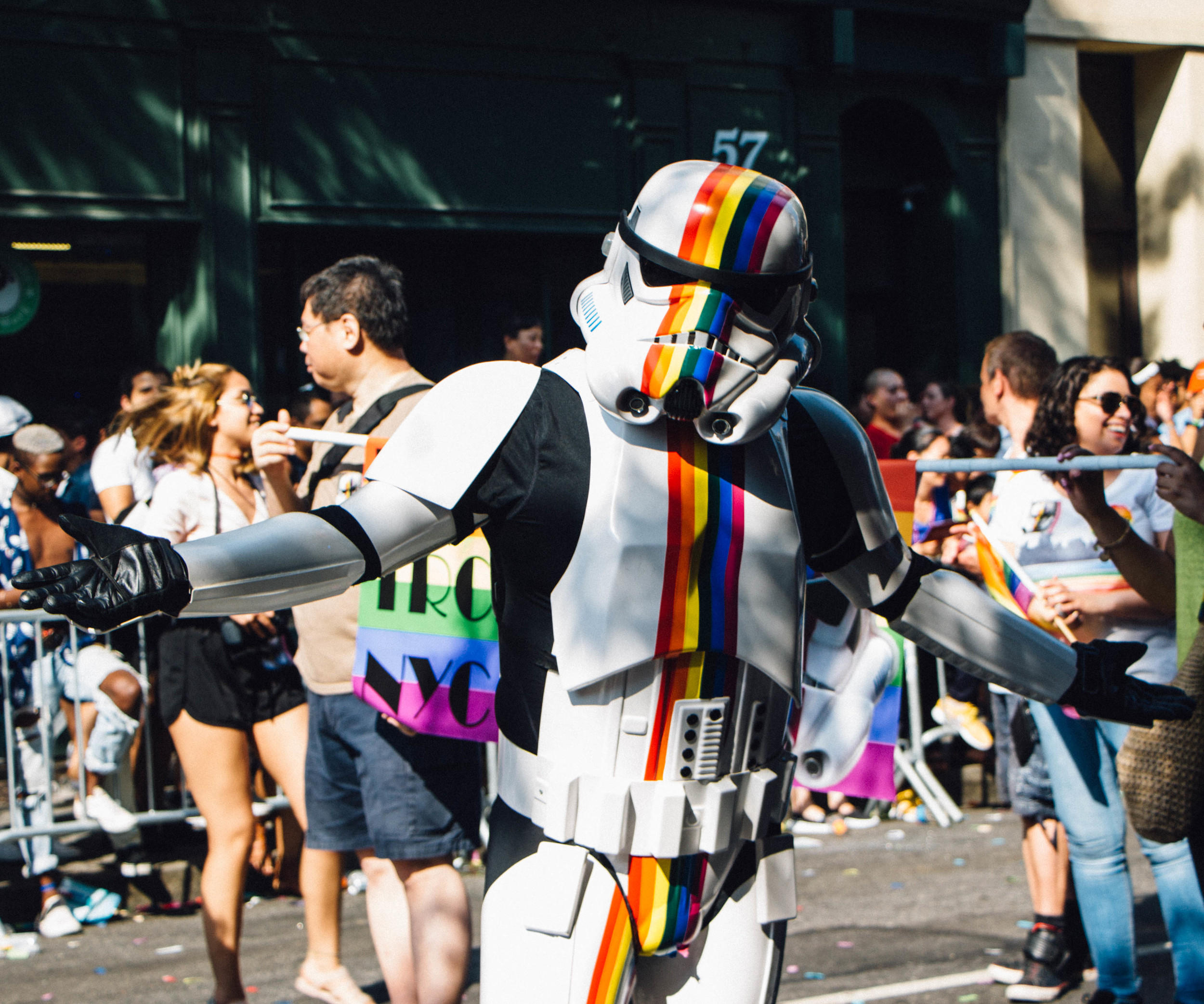 A gay pride Storm Trooper poses for cameras.