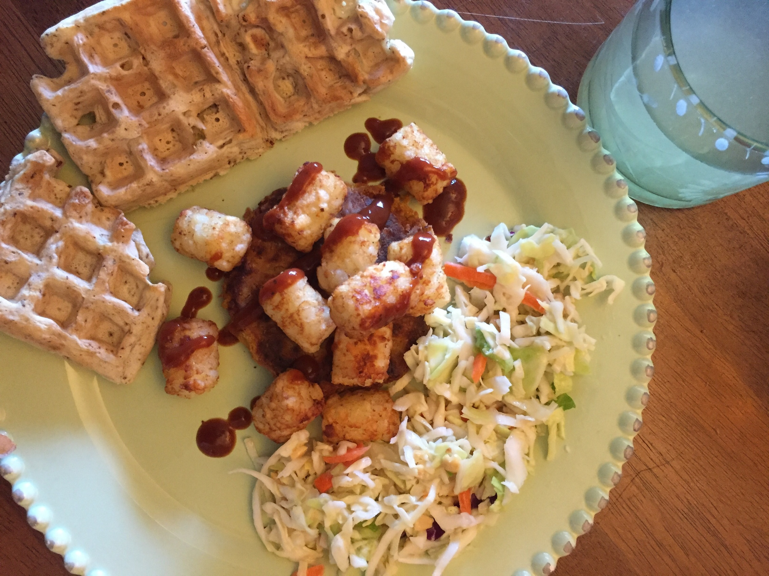 "The patty is a little hard to see. But here I ate it with the coleslaw I featured last week, tater-tots, and the savory waffles from my vegan ""chicken"" & waffles recipe a while back. Drizzled with barbecue sauce and ketchup and a glass of homemade lemonade to drink!"