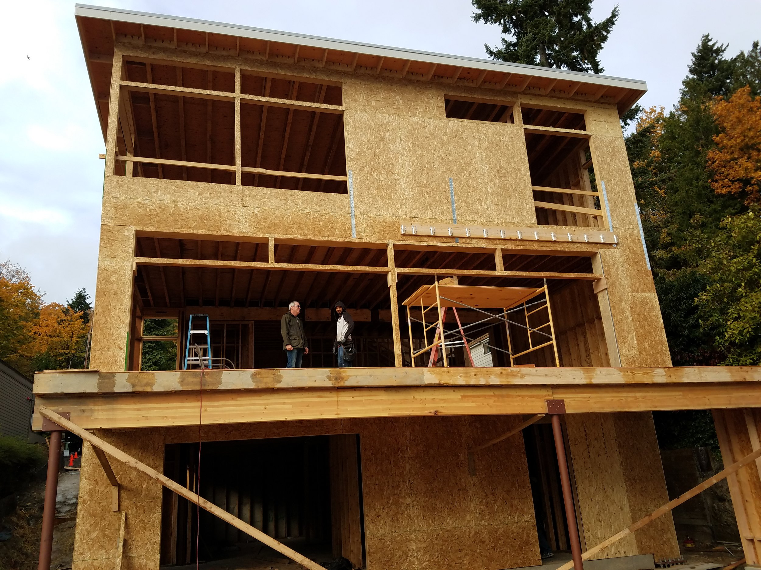 This home will enjoy maximum and unobstructed views of Lake Washington. In order to support three stories of windows, steel instrumentally supports the rest of the wood frame structure.