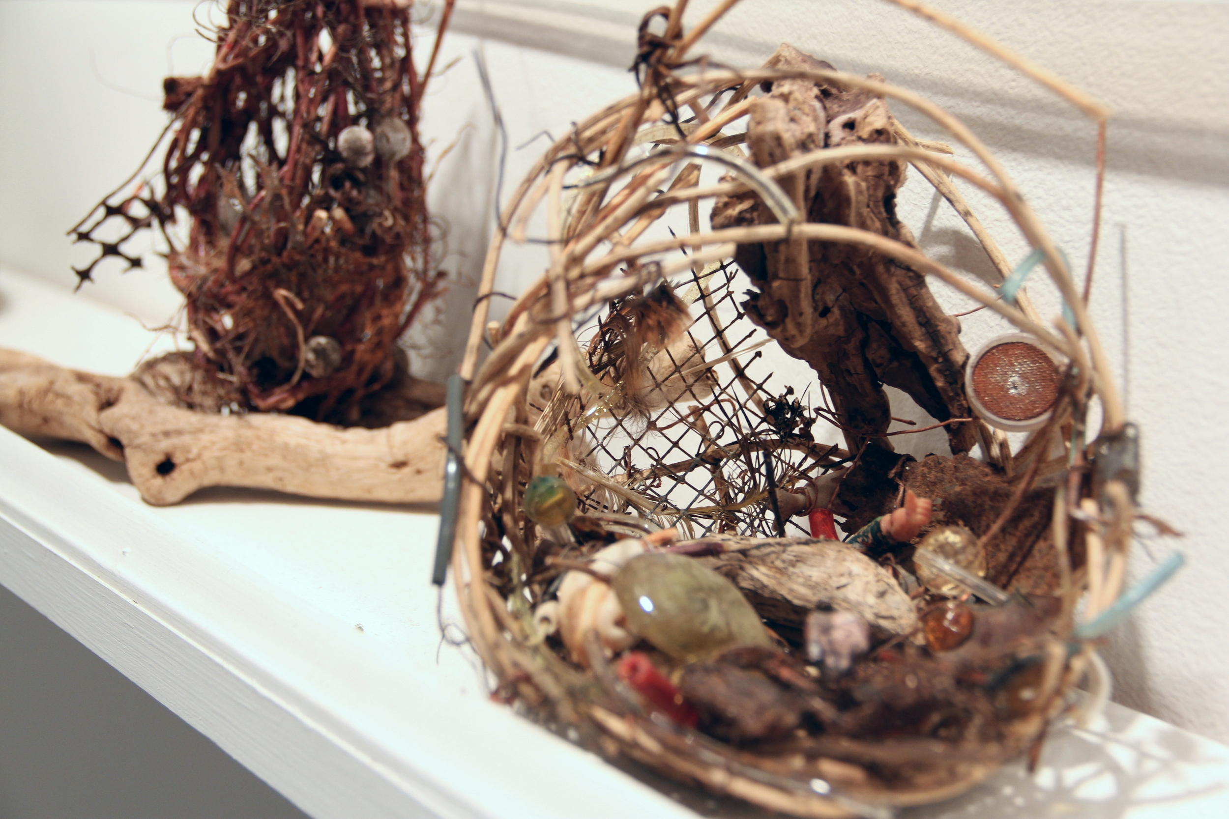 Detail of sculptural images by Kathy Dragomer.