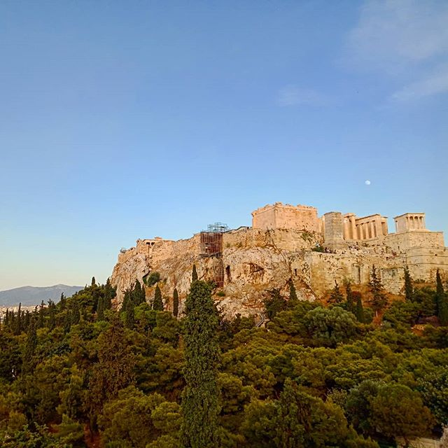An ancient rock, a sacred place Overlooking the gardens and squares where thoughts and minds were shaped The city surrounds, holding now and then And the gentle sphere watches peacefully on  #athina #acropolis  #adventures  #urbanexplorer