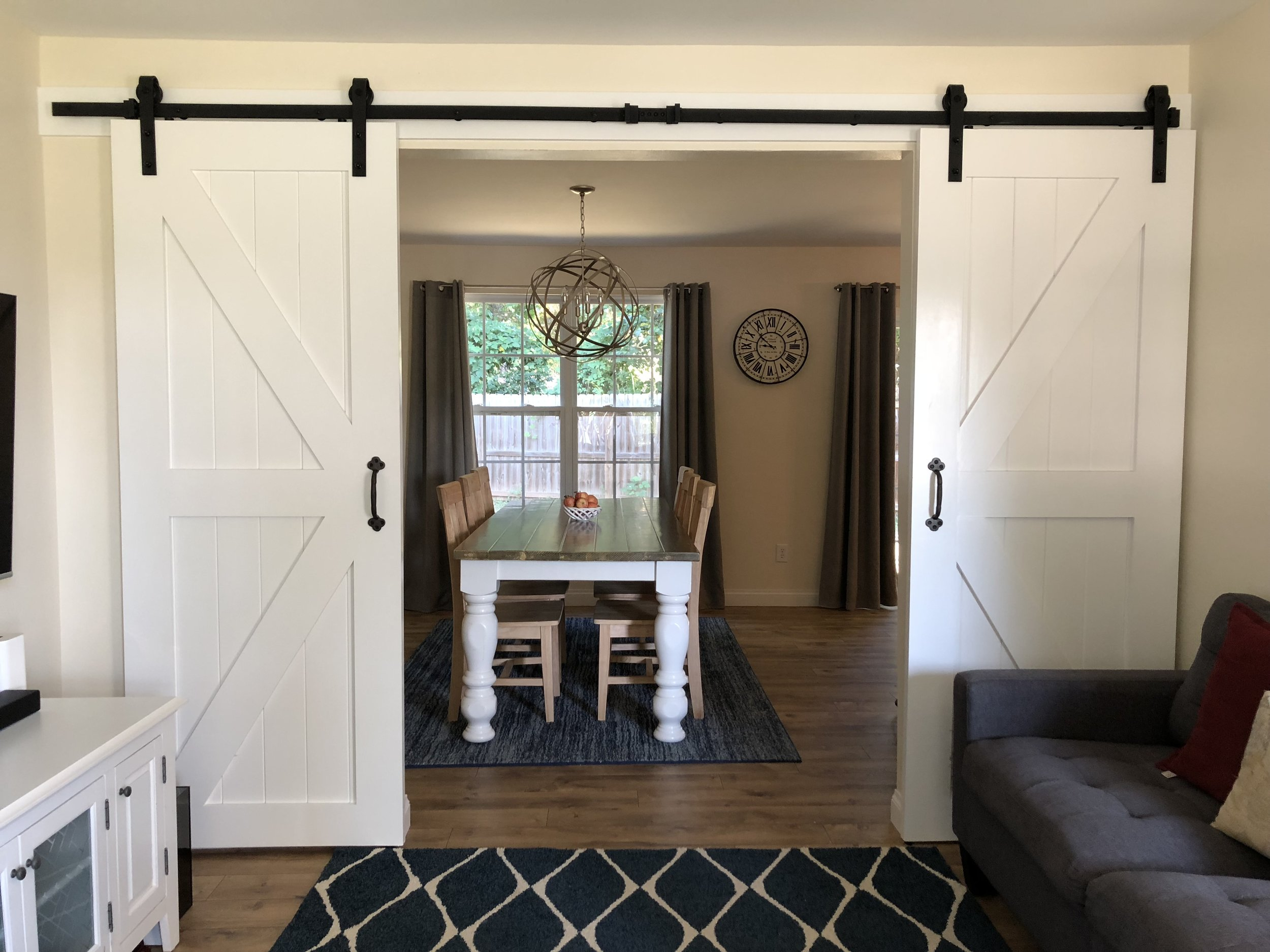 """It didn't happen right away but after some time my sweet husband built me some gorgeous barn doors. I absolutely love them! In the beginning I thought I wanted the popular """"open concept"""" kind of feel in my home but after a while I quickly realized that, that style doesn't really work for me. Or at least not right now while the kids are still little. I personally like to close them behind the doors, while having some tea time with a friend. The more peace and quiet the better. haha"""