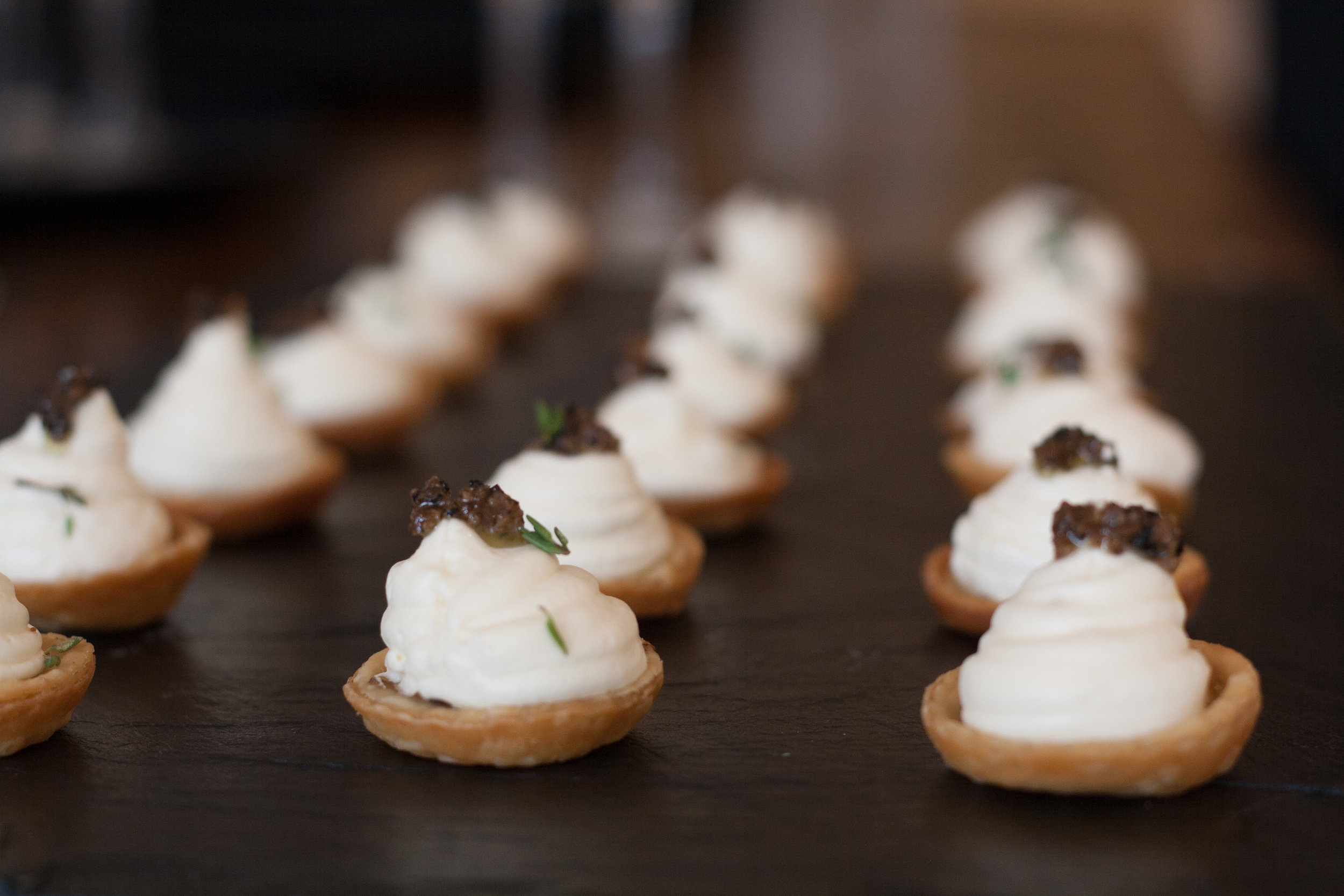 Whipped brie, black olive tapenade in butter pastry