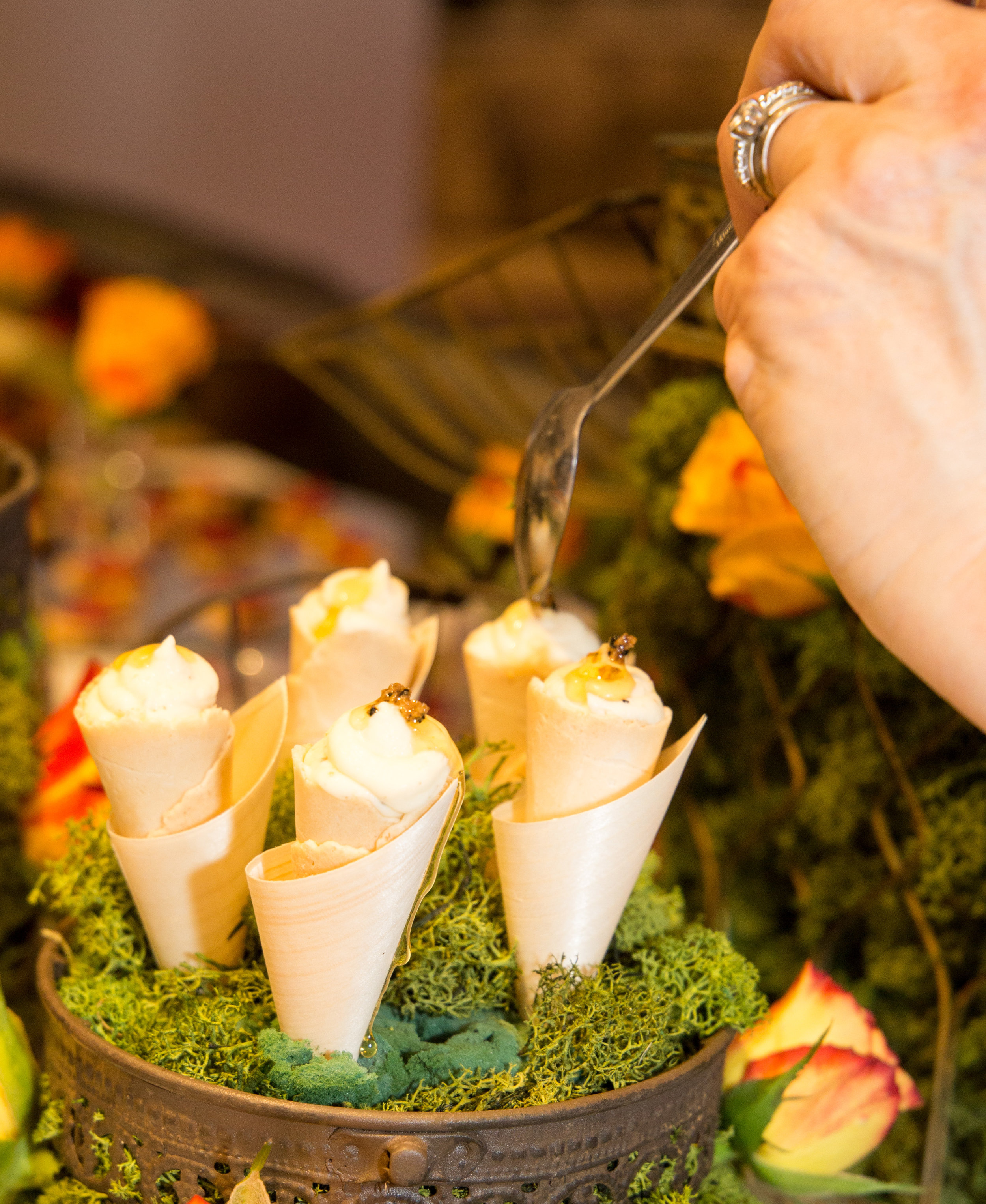 Whipped brie de meaux with a sprinkling of truffles and honey in mini cones