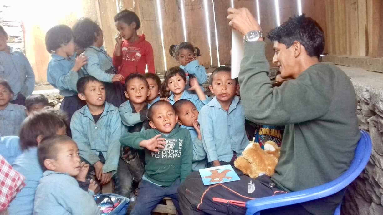 Babu Rijal, the expert Himalayan guide, showing the Teddy programme to the local school