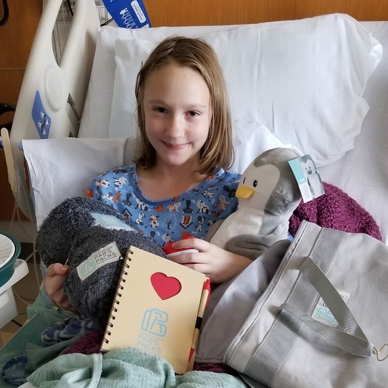 Sofia with her PAB'S PACK during a recent stay at Children's MN.