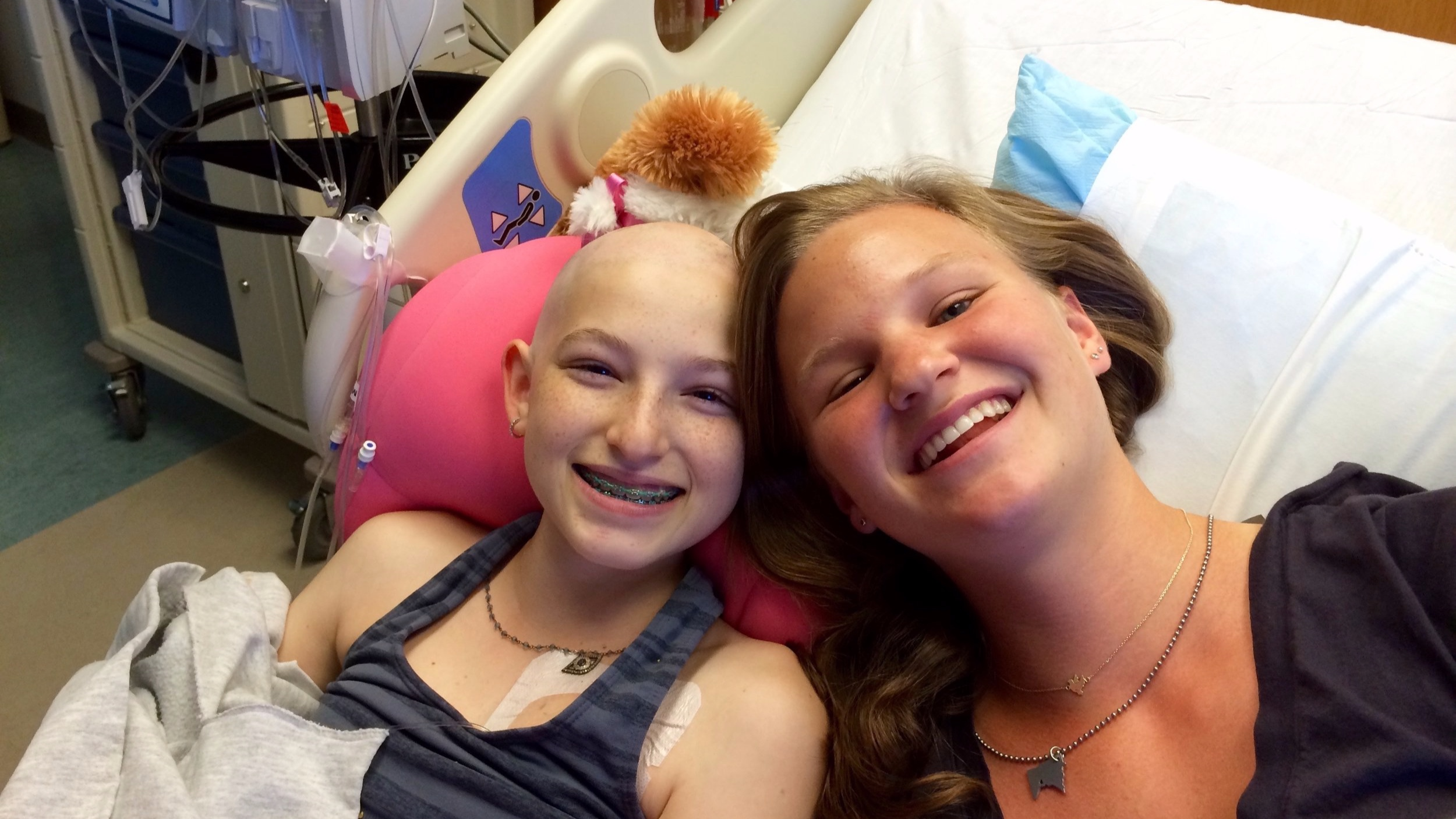 Abbie with Pia during a chemotherapy visit.