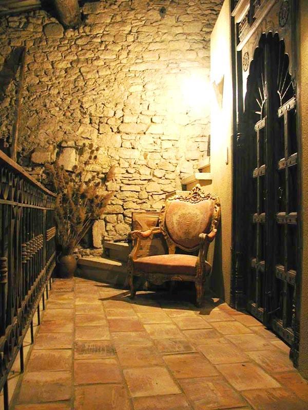 mezzanine with stone bathroomo, leading to owl's nest
