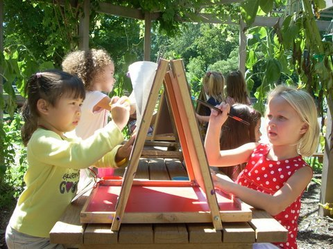 Painting is fun in the outdoor sunflower hut.