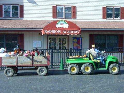 Children ride the hay wagon to pick pumpkins from our magical pumpkin patch