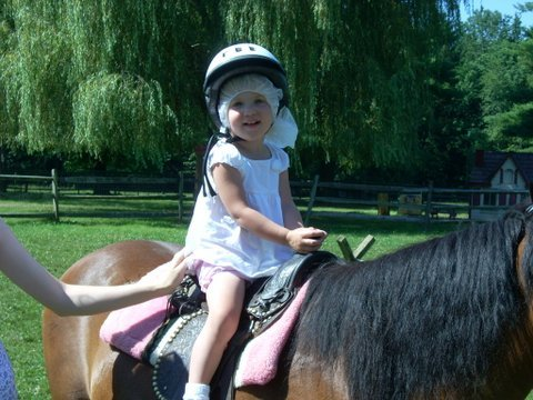Candy the pony giving pony rides