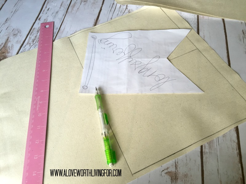 Use a pattern to trace your flags onto the back of the fabric.a