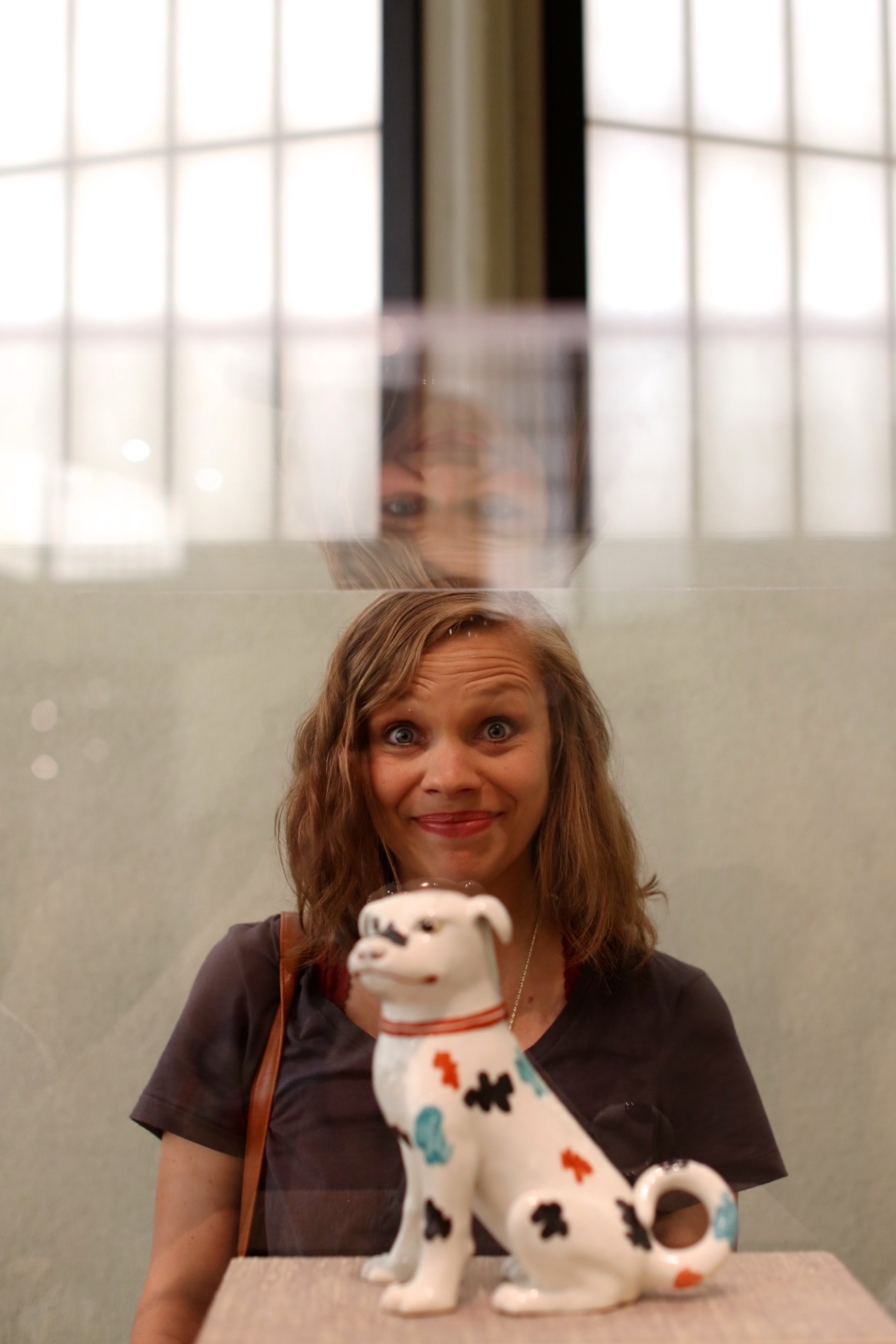 Abby and this ceramic dog in the Japanese Art Pavillon.