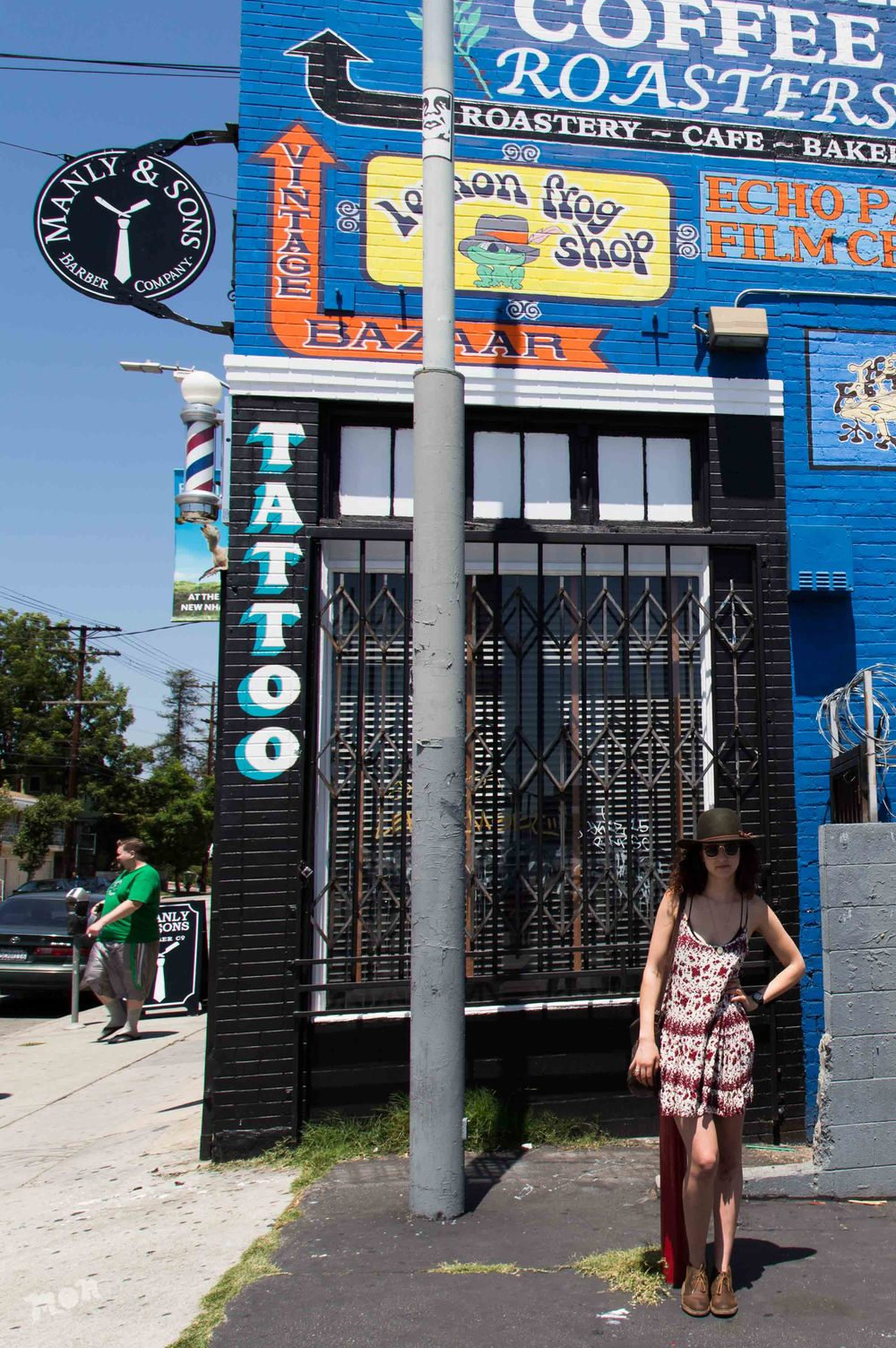 Hillary in front of a gentrified section of Echo Park on Sunset & Alvarado