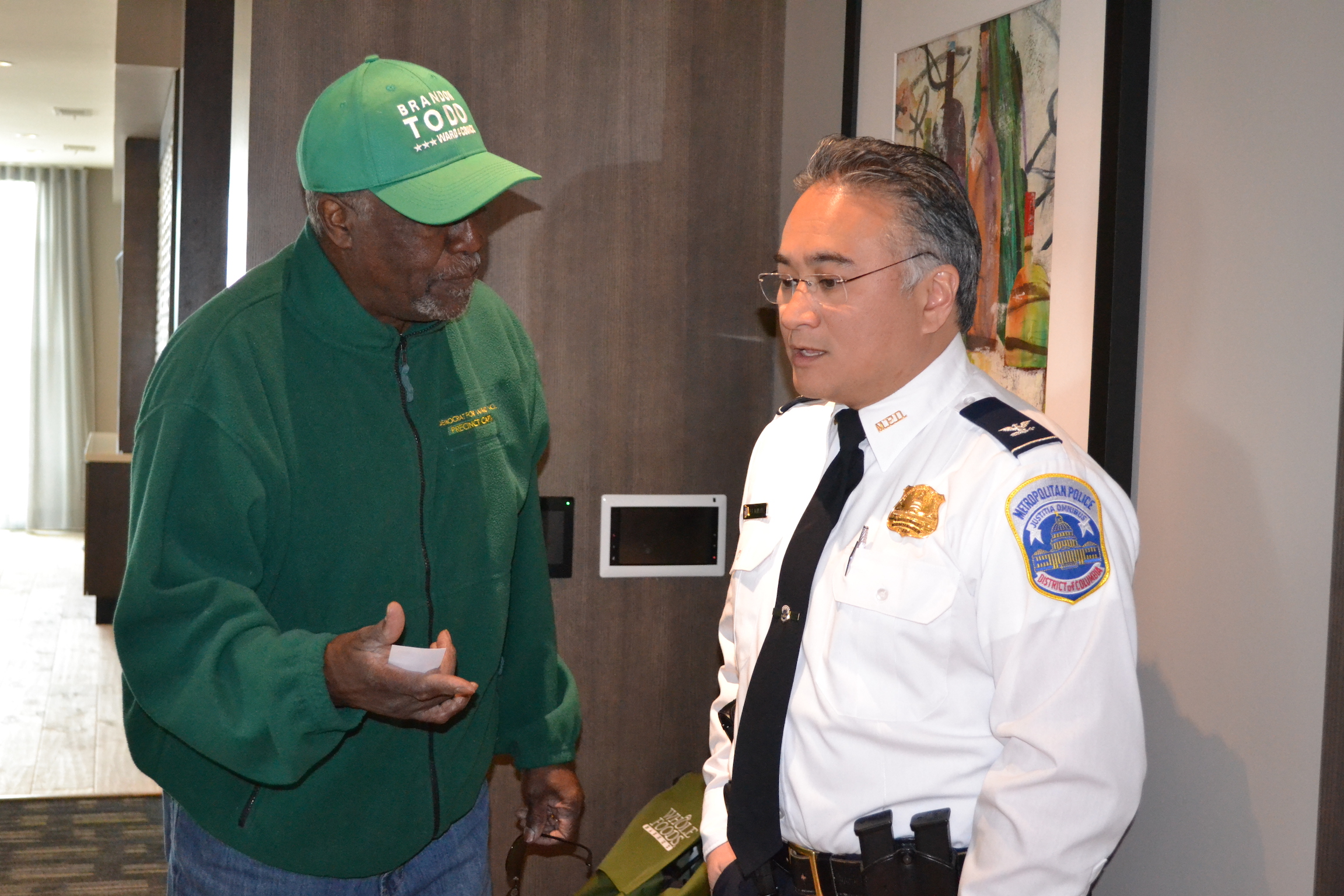 4D Commander Wilfredo Manlapaz speaking with a resident (decked out in Todd green).