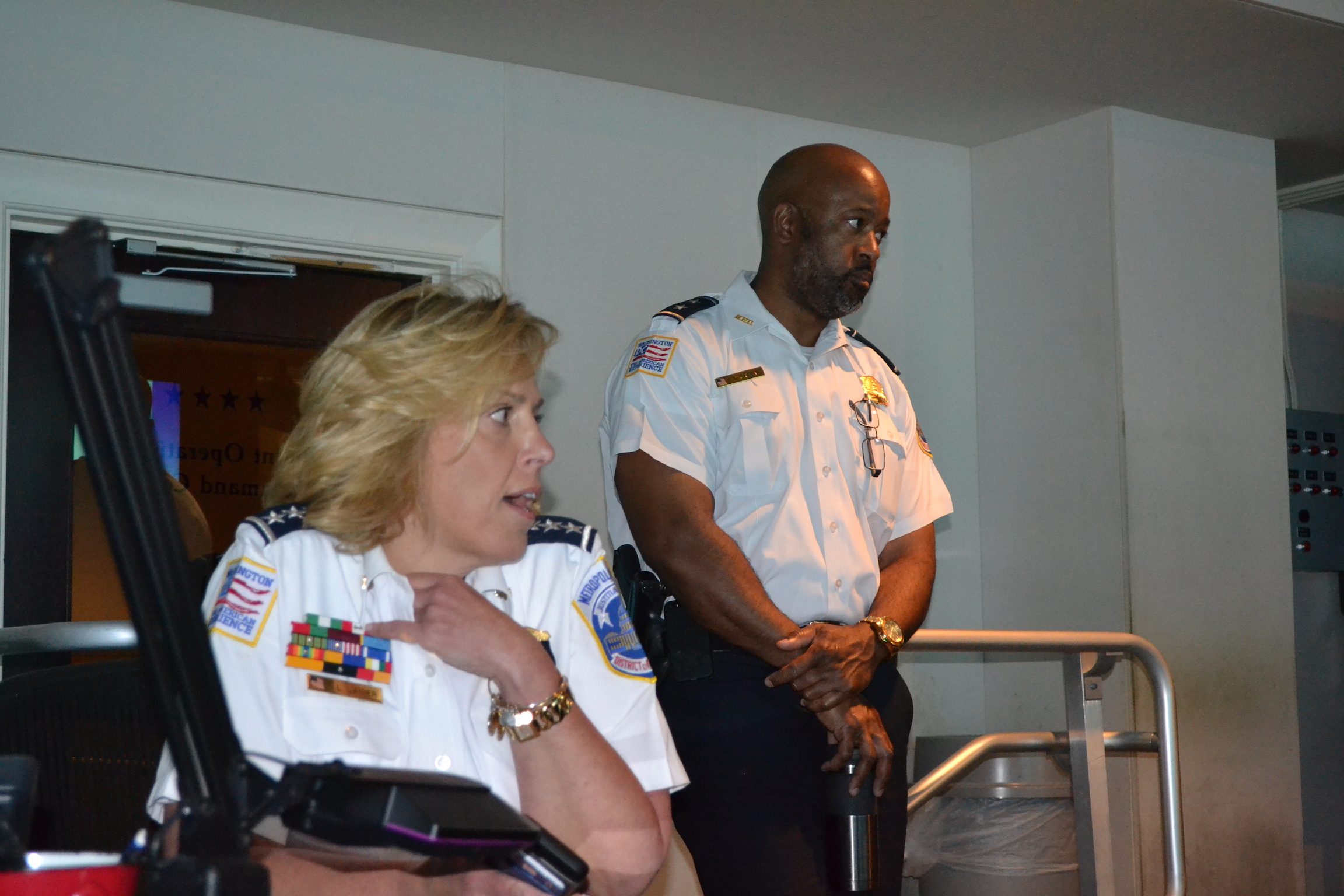 Chief Lanier answering a question; Assistant Chief Lamar Greene.
