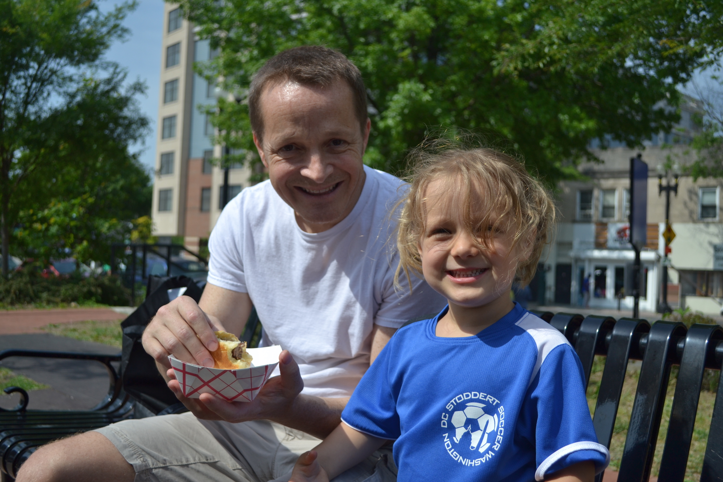 Marcus Carpenter and his daughter enjoying a Meat Crafters sausage.
