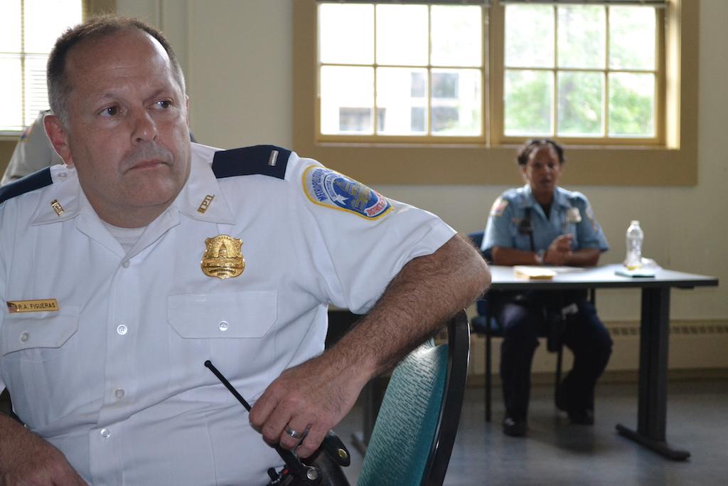 Lieutenant Raul Figueras PSA 404 manager. Officer Motley inthe back.