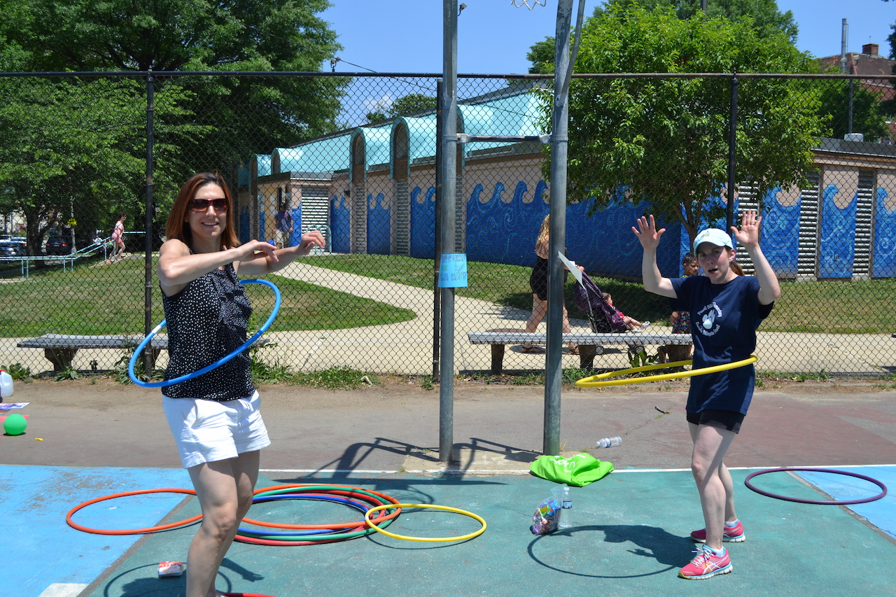 Heather and Carla showing off their mad hula hoop skills.     — with   Heather Schneider   and   Carla Ferris  .