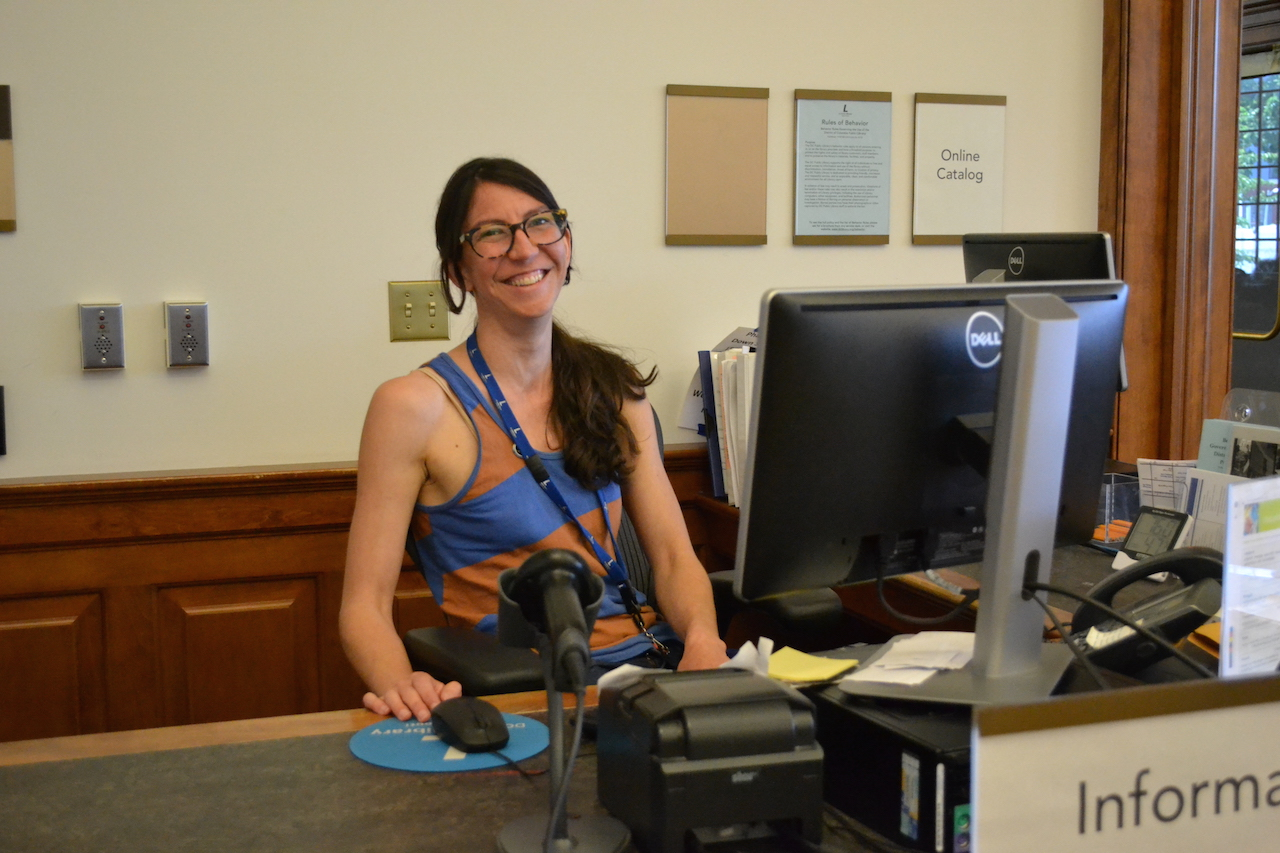 Adult Librarian Lisa Warwick with a big smile.