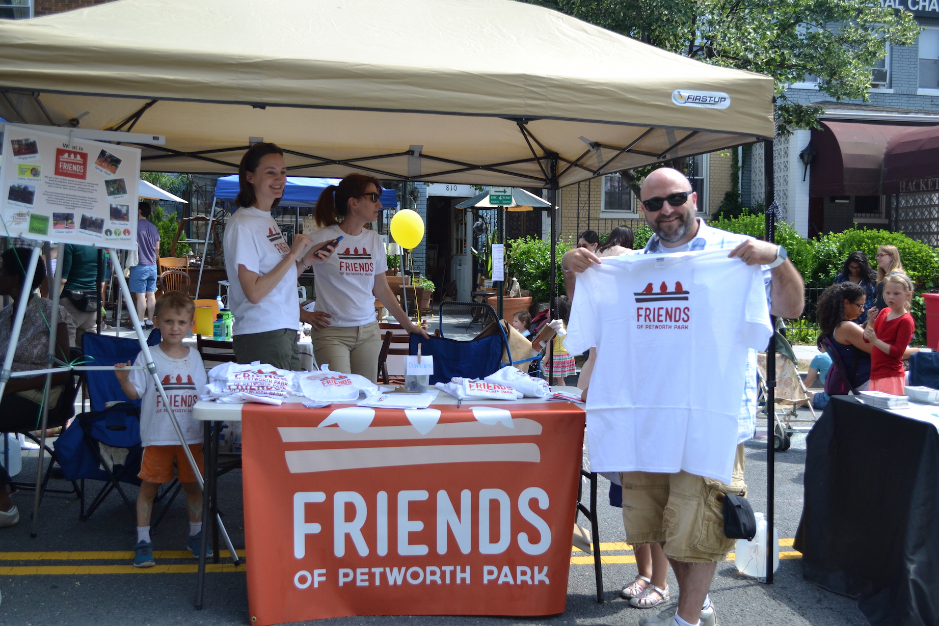 Drew buying a shirt and supporting the Friends of Petworth Park