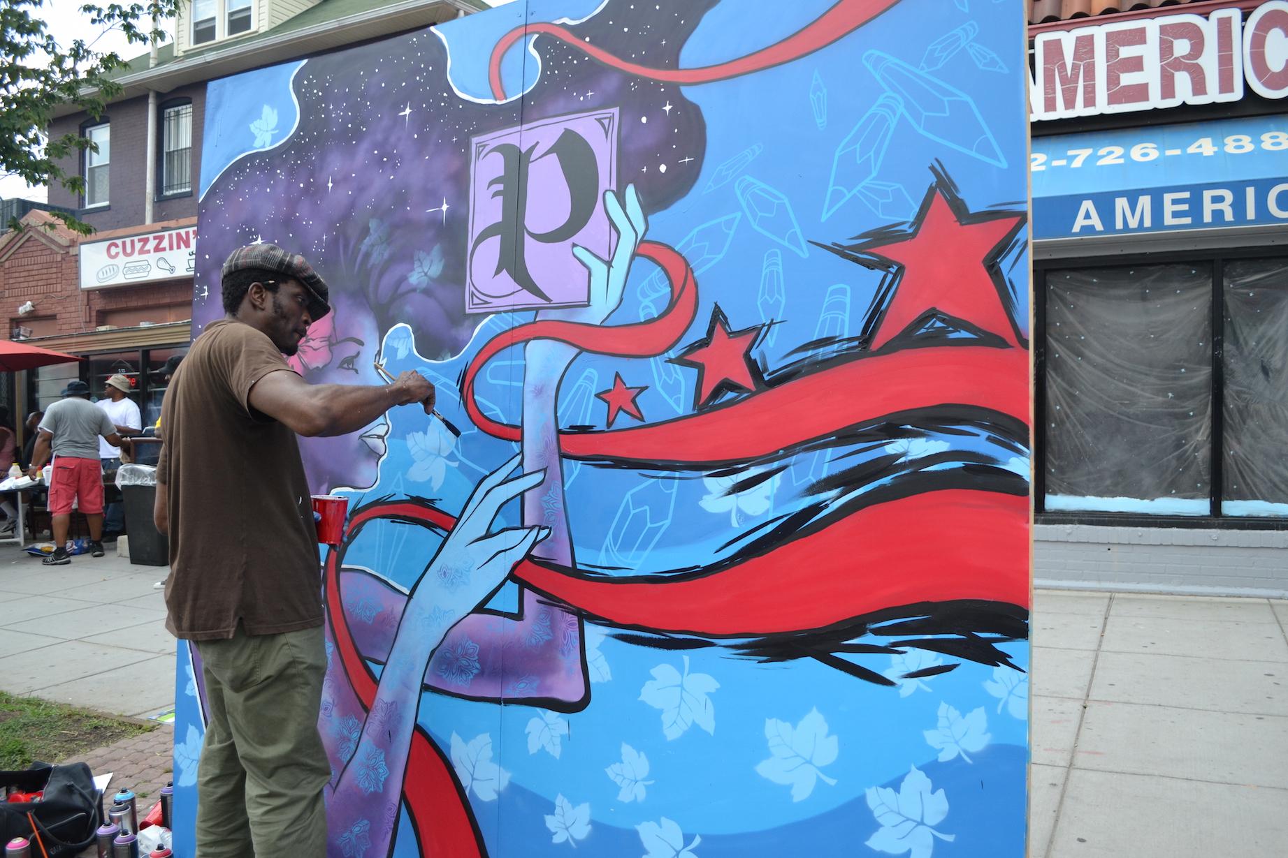 Aniekan Udofia painting an original work at the Festival ( http://www.aniekanudofia.com )
