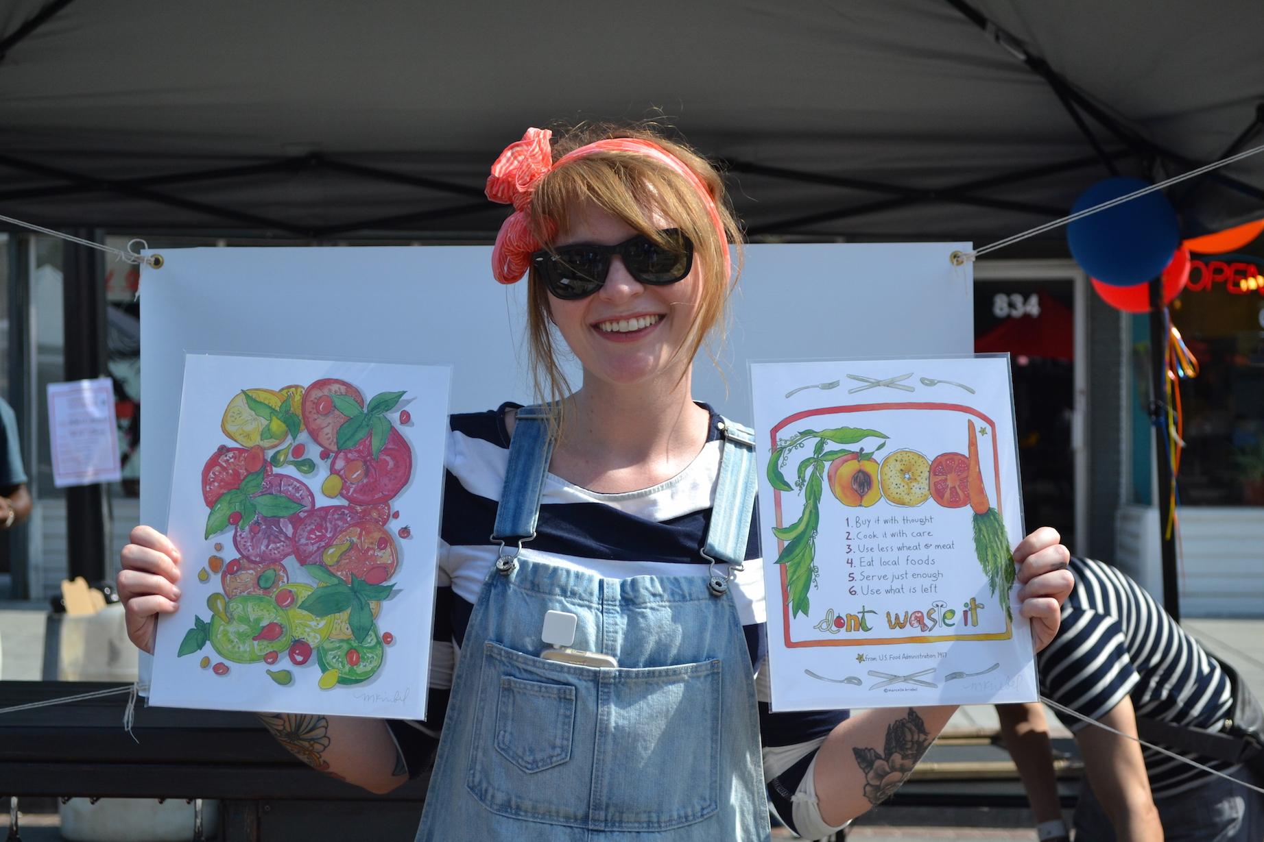 Pamela Carroll, selling really great art and cookbooks on behalf of local artist Marcella Kriebel .