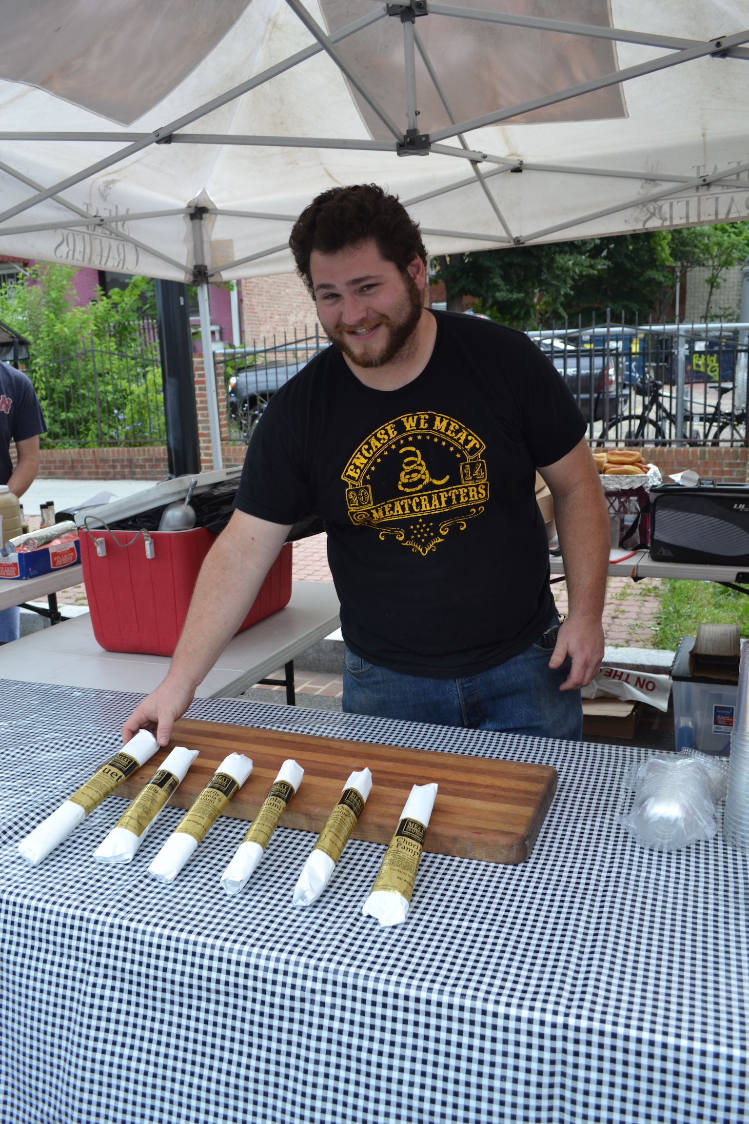 Owner Jeb Gavin showing off some of the dried sausages. You can get samples while you shop.