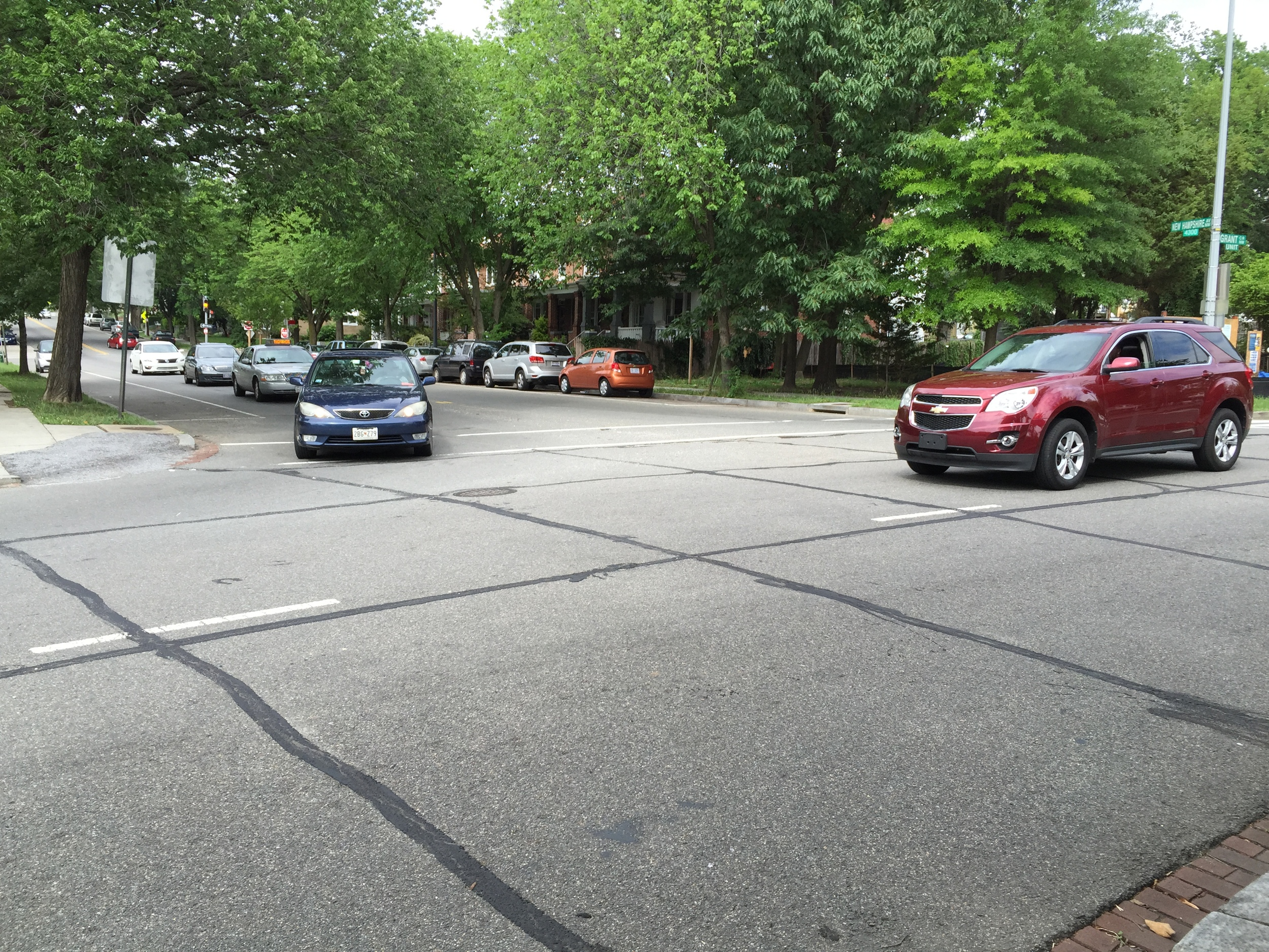 Northside of Grant Circle, where cars weave in and out of the circle.