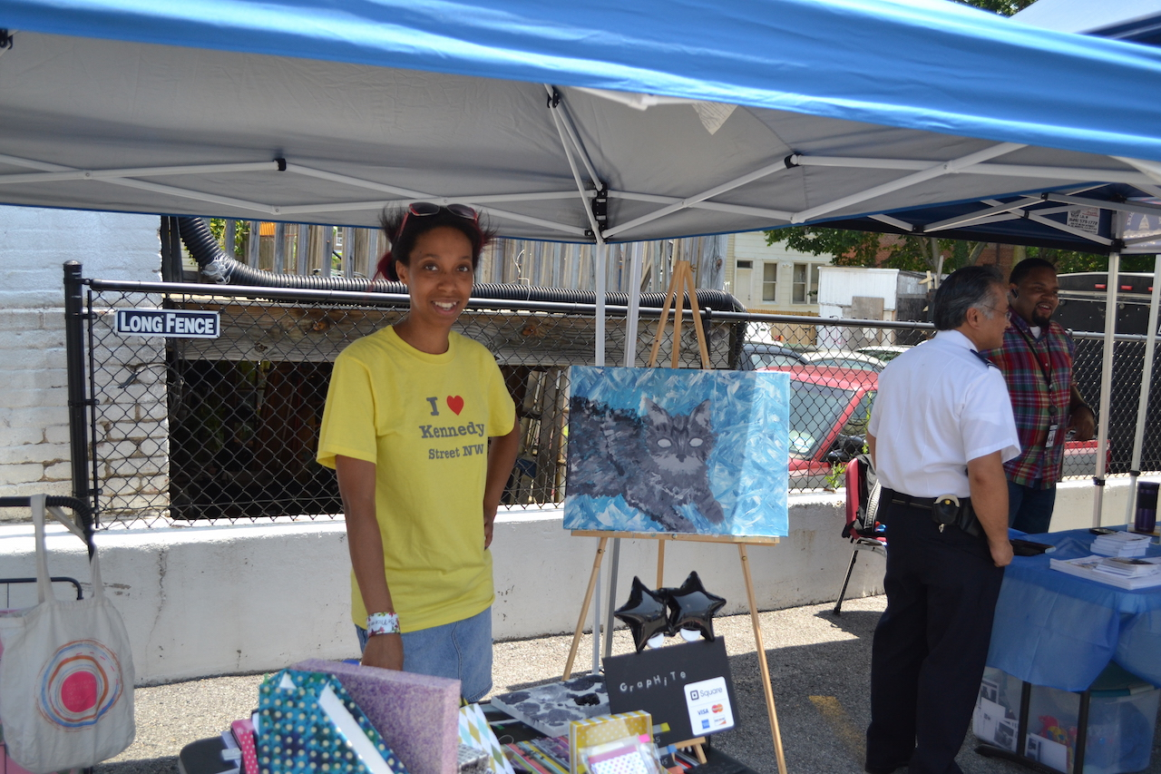 Natalie Jackson, selling her handmade notebooks and art (she's a teacher at Basis DC Public Charter school).