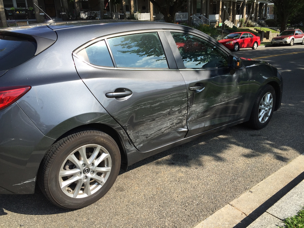 Damage to the Mazda that was traveling southbound on Kansas Avenue NW.