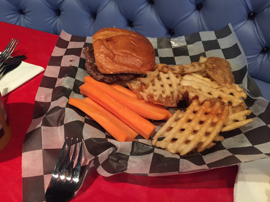 My daughter's kid's burger, complete with fries and carrots.