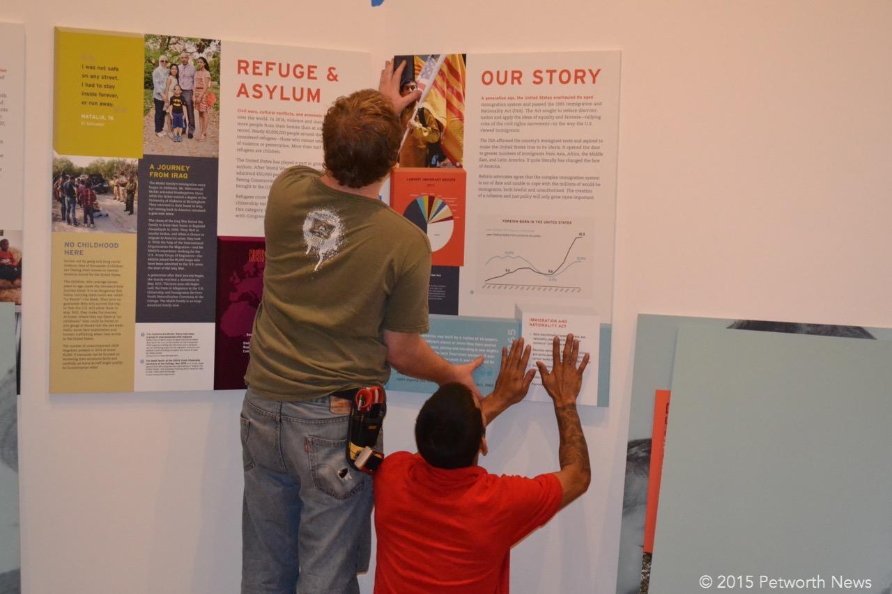Workers install the exhibit