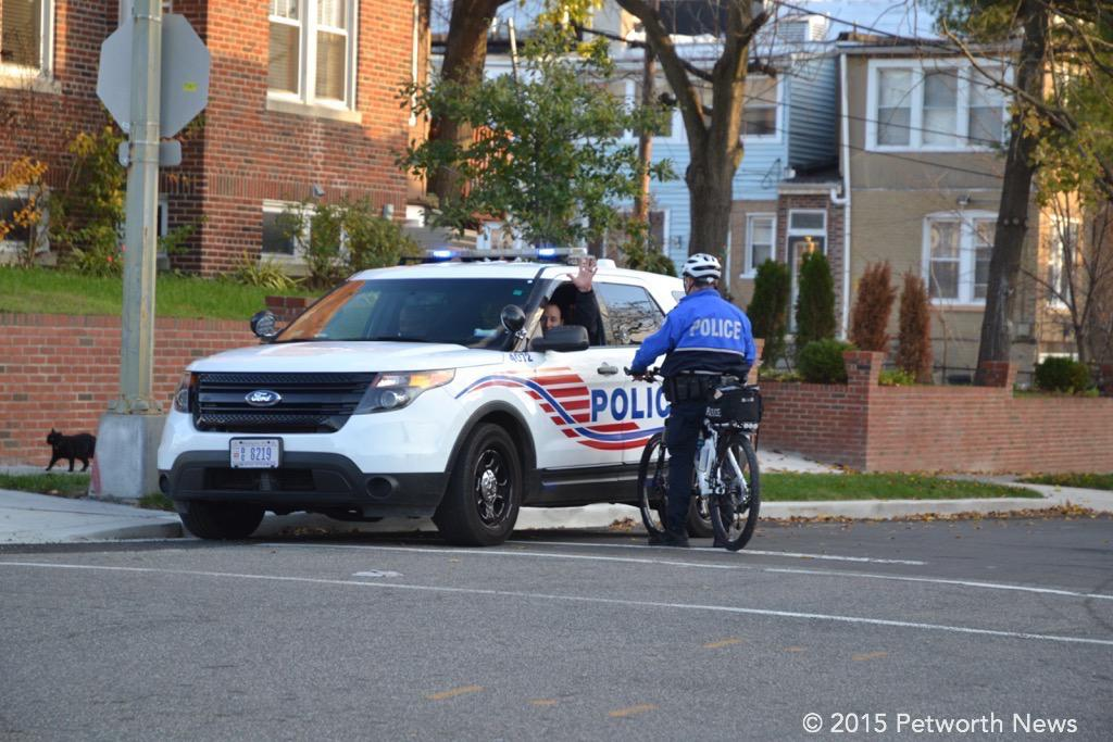 Officers patrolling along 7th Street NW