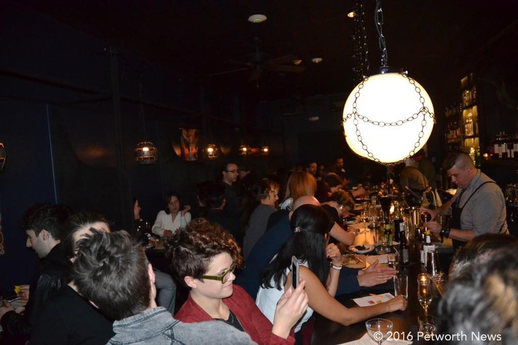 The crowd enjoying the mixed cocktails from the three bartenders.