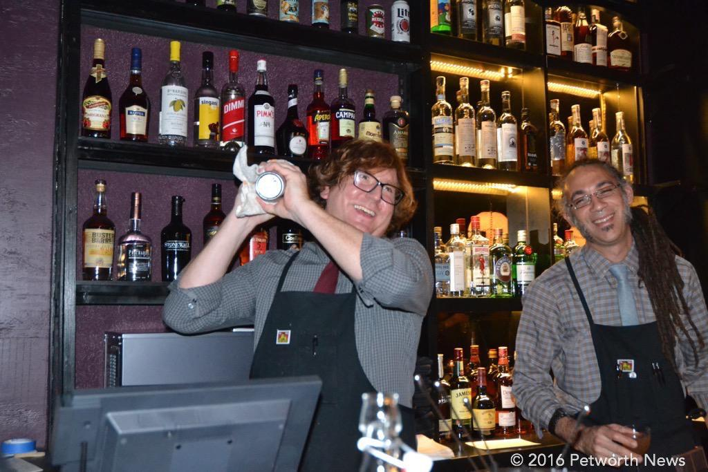 Bryan and Calvin mixed up drinks to order behind the bar.