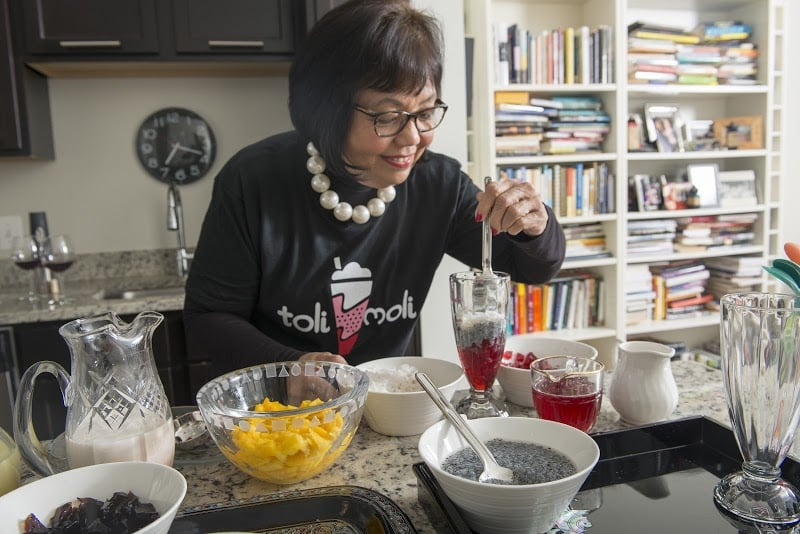 """Chef JoJo preparing a """"Royal Falooda"""" with pomegranate-ginger jellies, basil seeds, ginger milk, homemade rosewater syrup, pumpkin seeds and slivered almonds. (photo:Les Joueurs Photography)"""