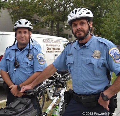 Bike patrol officers Christopher Glascock and Eric Frost at the Petworth Jazz Project.