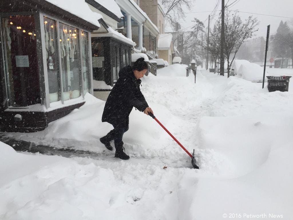 Kera Carpenter, owner of Domku, out cleaning the sidewalk