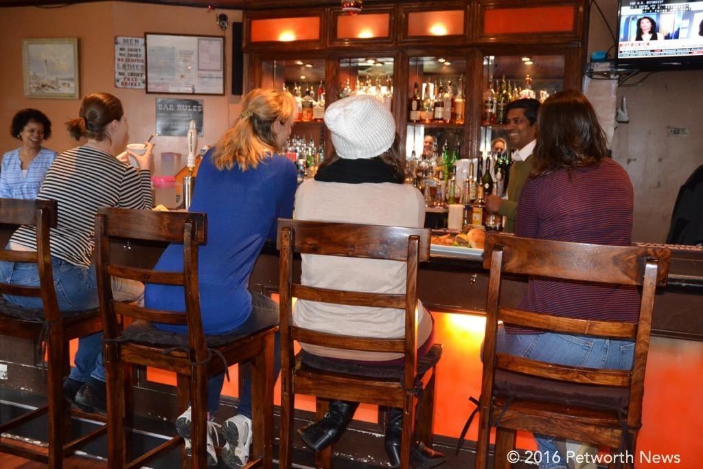 Patrons hanging out at the bar of the Hitching Post, 200 Upshur St NW