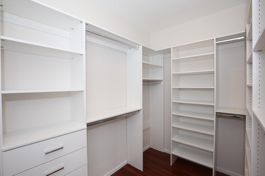 28-Walk-in ClosetBedroom 2 Master - Unit 4.jpg