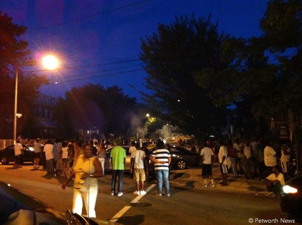 Petworth residents watching a local fireworks display in the street.