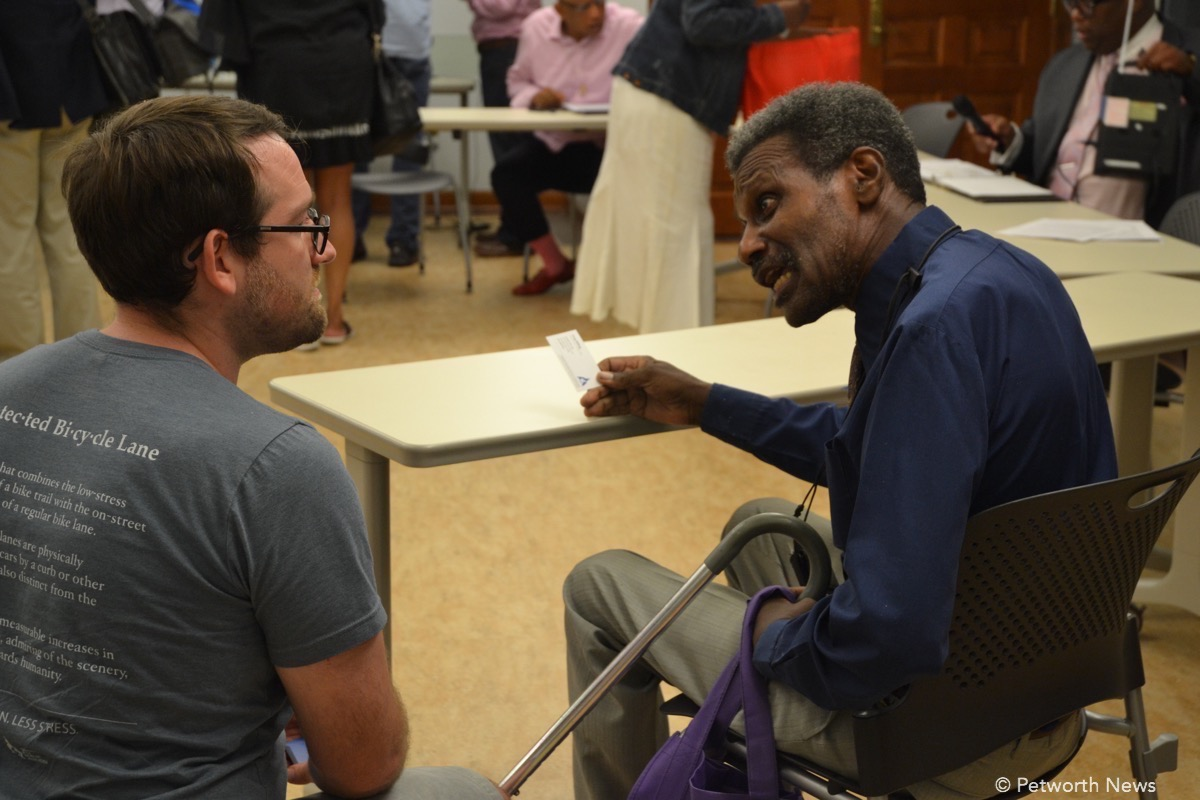 ANC 4C Commissioner Timothy Jones argues with Greg Billing, the Executive Director of the Washington Area Bicyclists Association at the August 10, 2016 meeting.