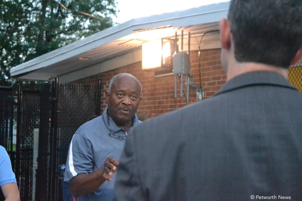 Resident Colbert King speaks to Deputy Mayor Kevin Donahue