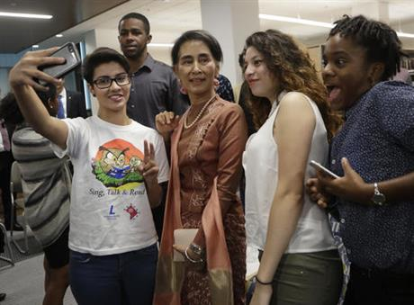 From left, Elsi Argueta, Cindy Mayen and Michannie Grant, 12th grade students from Roosevelt Senior High School in northwest Washington, pose for a selfie with Myanmar leader Aung San Suu Kyi, second from left, following a forum Thursday, Sept. 15, 2016. (  AP  Photo/Manuel Balce Ceneta )