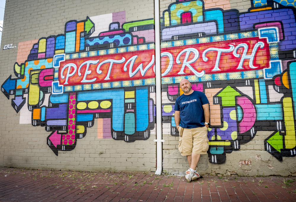 Drew doing the old school cool pose at the Petworth mural    (Photo:    Jason Hornick   /Washington Post)