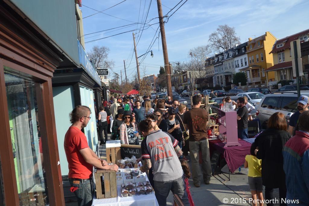 Neighbors fill the sidewalk at the 10th Annual Fair in 2015